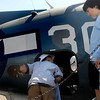 "N0923AIR6.jpg Jakob Maenpa (CQ), 9, right, and Tyler Williams, 10, check out a fighter plane during the Colorado Sport International Air Show on Saturday, Aug. 22, 2009 at the Rocky Mountain Metropolitan Airport in Broomfield. Watch the video and see more photos at  <a href=""http://www.dailycamera.com"">http://www.dailycamera.com</a>.<br /> <br /> VIDEO INLINE: VIDEO: VIDEO: BROOM AIR SHOW 2009<br /> <br /> Photo by Mara Auster/Daily Camera"