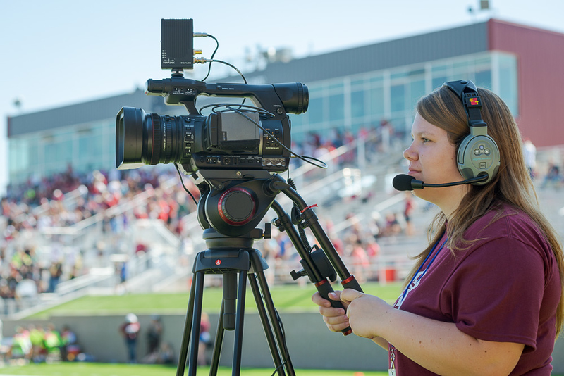 Kayla Reinke operates an end zone camera during a football game. (Photo by Dewayne Gimeson/Chadron State College)