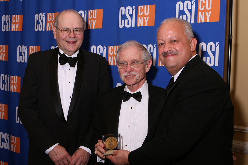 CSI President Dr. Tomás D. Morales (L) presents the President's Medal, with the assistance of Provost and Senior Vice President for Academic Affairs Dr. William Fritz (R), to Dr. Fred Naider, Distinguished Professor of Chemistry and Biochemistry at the College of Staten Island and a member of the Doctoral Faculty at The City University of New York.