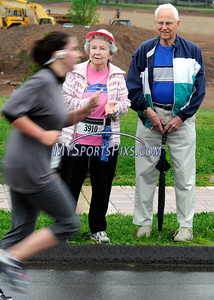 5/8/2010 Mike Orazzi | Staff Cancer survivor June Norton and her husband Don watch at runners approach the finish line during the men's 5K run at the Connecticut Race In The Park at Walnut HIll Park in New Britain on Saturday morning. (note, I know that is a woman running, she was competing in the men's race)