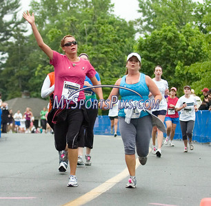 5/8/2010 Mike Orazzi | Staff Kathy Matula and Tracy Bette hold hands as they cross the finish line during the women's 5K run at the Connecticut Race In The Park at Walnut HIll Park in New Britain on Saturday morning.