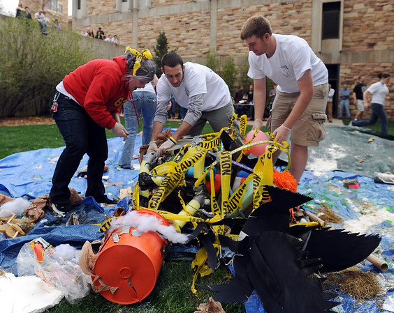 "Britta Ulm, left, Jordan Haines, and  Ben Miller sort through the crash site to find the status of the egg. <br /> Engineering students at the University of Colorado held the annual egg drop competition on Thursday April 22, 2010.<br /> For more photos and a video, go to  <a href=""http://www.dailycamera.com"">http://www.dailycamera.com</a>.<br /> Cliff Grassmick / April 22, 2010"