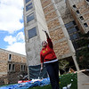 "Britta Ulm indicates that this egg did not survive the fall from the eighth floor.<br /> Engineering students at the University of Colorado held the annual egg drop competition on Thursday April 22, 2010.<br /> For more photos and a video, go to  <a href=""http://www.dailycamera.com"">http://www.dailycamera.com</a>.<br /> Cliff Grassmick / April 22, 2010"