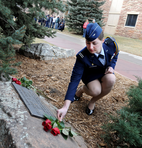 "Cadet Michelle Kennedy places a rose on the Ellison Onizuka Memorial near the CU Engineering Center, representing one of the crew lost in the Challenger explosion.<br /> Cadets from the University of Colorado Air Force ROTC Squadron held a memorial service to honor the lost crews of the Space Shuttles Challenger and Columbia on Saturday January 26th, 2013.<br /> For more photos and a video, go to  <a href=""http://www.dailycamera.com"">http://www.dailycamera.com</a><br /> <br /> Cliff Grassmick  / January 26, 2013"