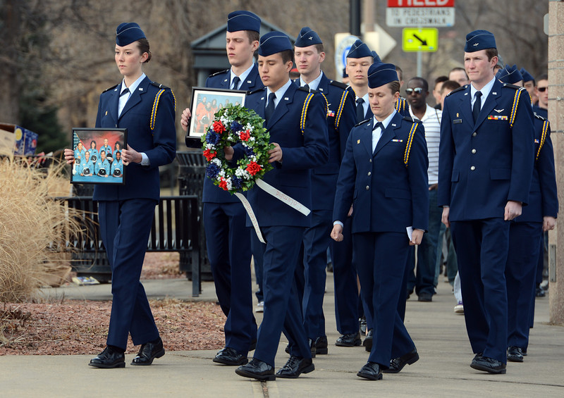 "Cadet, Sara Sawyer, left, holds a photo of the Challenger Space Shuttle Crew while marching to the memorial site with other ROTC members.<br /> Cadets from the University of Colorado Air Force ROTC Squadron held a memorial service to honor the lost crews of the Space Shuttles Challenger and Columbia on Saturday January 26th, 2013.<br /> For more photos and a video, go to  <a href=""http://www.dailycamera.com"">http://www.dailycamera.com</a><br /> <br /> Cliff Grassmick  / January 26, 2013"