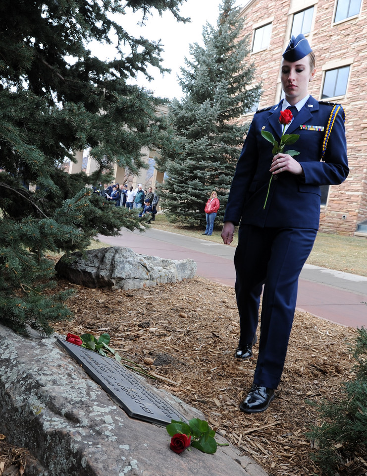 "Cadet Rachel Grosskrueger places a rose on the Ellison Onizuka Memorial near the CU Engineering Center, representing one of the crew lost in the Challenger explosion.<br /> Cadets from the University of Colorado Air Force ROTC Squadron held a memorial service to honor the lost crews of the Space Shuttles Challenger and Columbia on Saturday January 26th, 2013.<br /> For more photos and a video, go to  <a href=""http://www.dailycamera.com"">http://www.dailycamera.com</a><br /> <br /> Cliff Grassmick  / January 26, 2013"