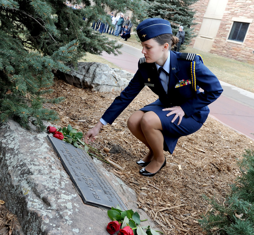 "Cadet Liz Notary places a rose on the Ellison Onizuka Memorial near the CU Engineering Center, representing one of the crew lost in the Challenger explosion.<br /> Cadets from the University of Colorado Air Force ROTC Squadron held a memorial service to honor the lost crews of the Space Shuttles Challenger and Columbia on Saturday January 26th, 2013.<br /> For more photos and a video, go to  <a href=""http://www.dailycamera.com"">http://www.dailycamera.com</a><br /> <br /> Cliff Grassmick  / January 26, 2013"