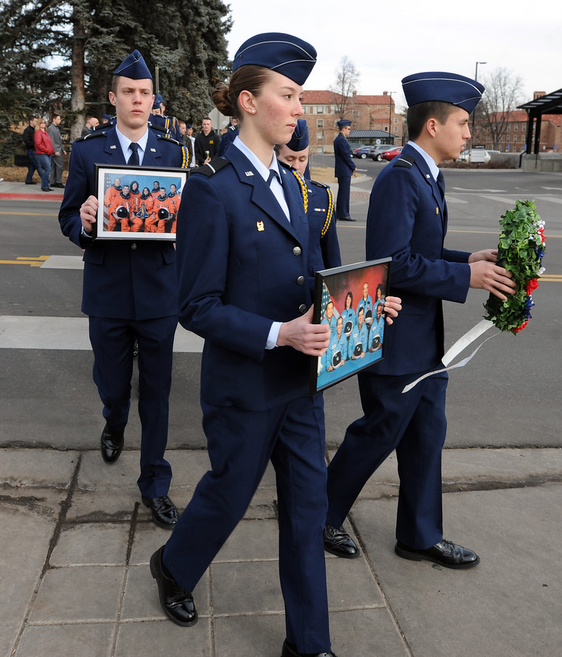 "Eric Anderson, left, Sara Sawyer, and Carlos Lawrence, lead a group of cadets to the memorial sites on the CU campus.<br /> Cadets from the University of Colorado Air Force ROTC Squadron held a memorial service to honor the lost crews of the Space Shuttles Challenger and Columbia on Saturday January 26th, 2013.<br /> For more photos and a video, go to  <a href=""http://www.dailycamera.com"">http://www.dailycamera.com</a><br /> <br /> Cliff Grassmick  / January 26, 2013"