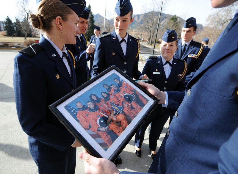 "AIr Force ROTC cadets  gather around a photo of the Columbia Space Shuttle Crew before the ceremony on the CU campus.<br /> Cadets from the University of Colorado Air Force ROTC Squadron held a memorial service to honor the lost crews of the Space Shuttles Challenger and Columbia on Saturday January 26th, 2013.<br /> For more photos and a video, go to  <a href=""http://www.dailycamera.com"">http://www.dailycamera.com</a><br /> <br /> Cliff Grassmick  / January 26, 2013"