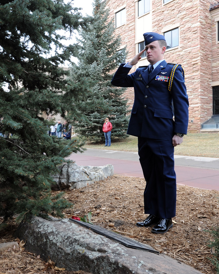 "Cadet Dillon Thorse salutes after  placing  a rose on the Ellison Onizuka Memorial near the CU Engineering Center, representing one of the crew lost in the Challenger explosion.<br /> Cadets from the University of Colorado Air Force ROTC Squadron held a memorial service to honor the lost crews of the Space Shuttles Challenger and Columbia on Saturday January 26th, 2013.<br /> For more photos and a video, go to  <a href=""http://www.dailycamera.com"">http://www.dailycamera.com</a><br /> <br /> Cliff Grassmick  / January 26, 2013"