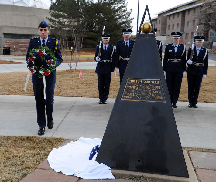 """Cadet Carlos Lawrence places a wreath at one of the space shuttle memorial sites on Saturday.<br /> Cadets from the University of Colorado Air Force ROTC Squadron held a memorial service to honor the lost crews of the Space Shuttles Challenger and Columbia on Saturday January 26th, 2013.<br /> For more photos and a video, go to  <a href=""""http://www.dailycamera.com"""">http://www.dailycamera.com</a><br /> <br /> Cliff Grassmick  / January 26, 2013"""