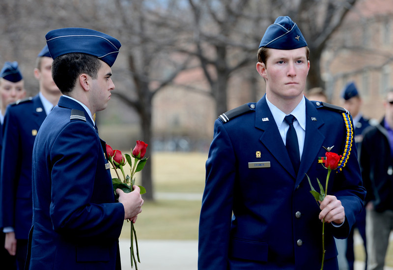 "Cadet, Scott Cromer, right, takes rose to be placed at the Ellison Onizuka Memorial.<br /> Cadets from the University of Colorado Air Force ROTC Squadron held a memorial service to honor the lost crews of the Space Shuttles Challenger and Columbia on Saturday January 26th, 2013.<br /> For more photos and a video, go to  <a href=""http://www.dailycamera.com"">http://www.dailycamera.com</a><br /> <br /> Cliff Grassmick  / January 26, 2013"