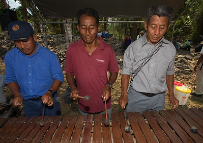 Men playing the marimba in the main plaza at Lubaantun where the Deer Dance is being performed. Toledo, Belize.