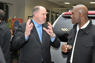 DSM Luxury and Cadillac of Las Vegas present the 2011 Luxury Preview Event hosted in the Cadillac of Las Vegas Showroom with celebrity boxer Evander Holyfield 5-times World Champion. Guests enjoyed viewing the 2011 Cadillac Models, a showcase of other luxury sponsors including Jewelry by Judith Ripka, $500,000 WyMar Art Lounge, all while enjoying a hosted bar sponsored by Castle Brands, incredible wines by JAQK Cellars, passed appetizers and live entertainment. Photographs by Mark Bowers for reallyvegasphoto.com