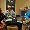 Tyler Duffy of Campground Automation (right) laughs while meeting with campground operators during informal breakout sessions at CalARVC's Software Education Day.