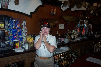 Rio Vista Barmaid sporting motorcycle helmet behind the Bar