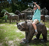 • Barberville Produce<br /> • Richard Thomas riding a metal brown bear