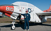 One old jet planes with and an old timer pilot standing next to it.