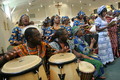 Members of the Cameroon Catholic Community choir sing during the Mass on the Feast of the Assumption of the Blessed Virgin Mary.