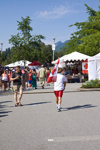 Canada Day 2013 at Lafarge Lake, Coquitlam. Councilor Mike Forrest shows his hometown pride