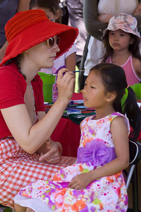 Canada Day 2013, Port Coquitlam, Castle Park. Sarah Ma of Port Coquitlam gets her face painted