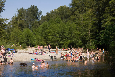 Crowds gather along the Coquitlam River in Port Coquitlam to cool off from the hot weather, Canada Day 2013