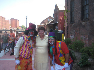 Our Mayor posing with the clowns!