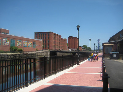 Groups of children walking on the Canal Walk.  Children's Museum on left, across the canal.