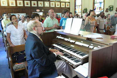 The congregation sings as Michael Kingsbury plays the organ. Kingsbury was the Cantonment Chapel organist for 30 years.