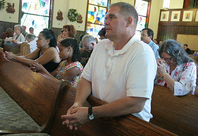 Mike Knippel, retired military, attends the final daily Mass at the Cantonment Chapel, June 7.  (Page 11, June 23, 2011 issue)