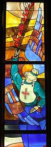 The stained glass window of St. Michael the Archangel is one of two windows in the chapel designed by Cistercian monk Father Methodius Telnack from the Monastery of the Holy Spirit, Conyers. St. Michael was the patron saint of the Cantonment Chapel.  (Page 10, June 23, 2011 issue)