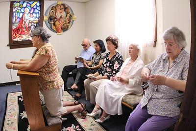 (Clockwise from left) Susana Burdeshaw (kneeling), Charles Rickmond, Lee Anderson, Felipa Bonoan, Janina Kresyman and Angela Quirke pray the rosary prior to the final Sunday Liturgy. Over the years they gathered to say the rosary on the first Sunday of each month and every Sunday during the months of May and October.  (Page 11, June 23, 2011 issue)