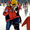 Capitals Season Ticket Holder Skate: Courtney and Slapshot pose for a picture