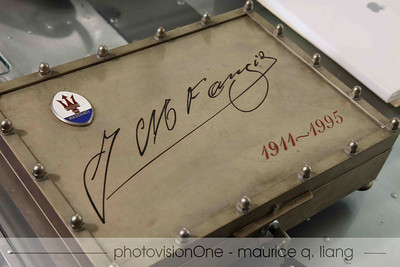 Autographed by Juan Fangio.