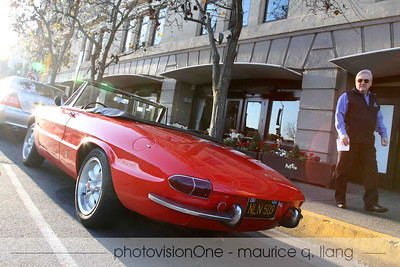 Gary Anderson, Editor of Mercedes Club of America Star Magazine, checks out this Alfa.