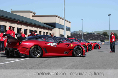 XX cars staged in pit row.