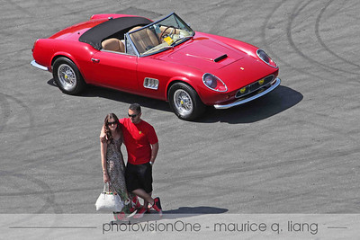 Couple stops to pose with a classic Ferrari California.