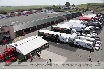 Paddock area with team trailers.