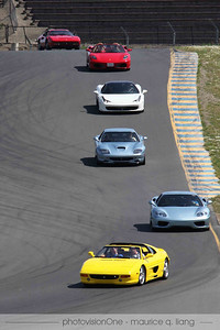 Kevin Enderby leads the group in his yellow 355.