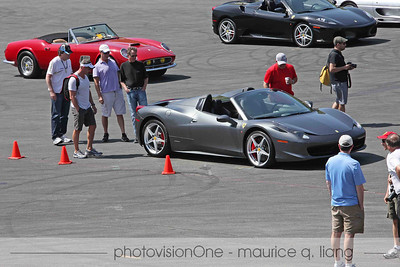 Crowd checks out Larry Brackett's new 458 Spider.