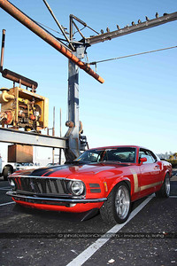 "Brave Mustang owner parks under this lift -- a perch for the local pigeons...  ""Hey George, check out the target below..."""