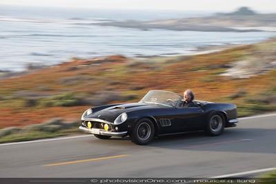 Winston Goodfellow driving down the coast in a classic Ferrari.
