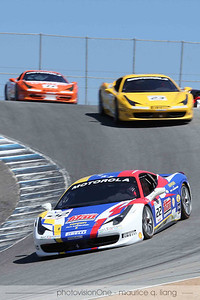 Ferrari Challenge cars in the Laguna Seca corkscrew.