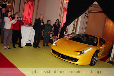 Thomas Klein of the Fairmont has the honor of driving the 458 Spider into the room.
