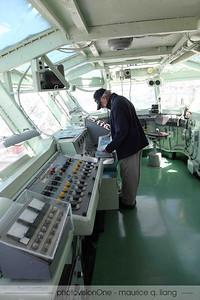 Tom in the aircraft control tower of the ship.