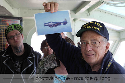 Tom shows us a photo of the type of plane he flew.