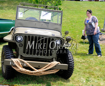 6/18/2011 Mike Orazzi | Staff Karyn Burns looks at a 1942 Ford GPW WWII Jeep during the Klingberg Vintage Motor Car Festival at the Klingberg campus on Linwood Street in New Britain on Saturday.