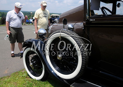 6/18/2011 Mike Orazzi | Staff Steve McGuff talks about his 1929 Model A Tudor with Jerry Olson (left) during the Klingberg Vintage Motor Car Festival at the Klingberg campus on Linwood Street in New Britain on Saturday.