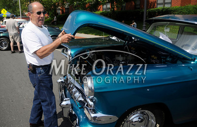 "6/18/2011 Mike Orazzi | Staff Robert ""Bobby"" Gasparri lowers the hood on his 1954 Chevrolet during the Team Bristol 2011 Car Show on North Main Street in Bristol on Saturday."
