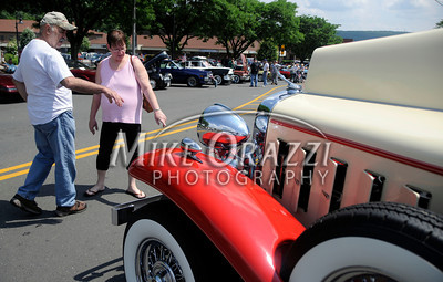 6/18/2011 Mike Orazzi | Staff Max and Darlene Garcia look at a 1932 Cadillac Fleetwood on North Main Street during the Team Bristol 2011 Car Show  in Bristol on Saturday.